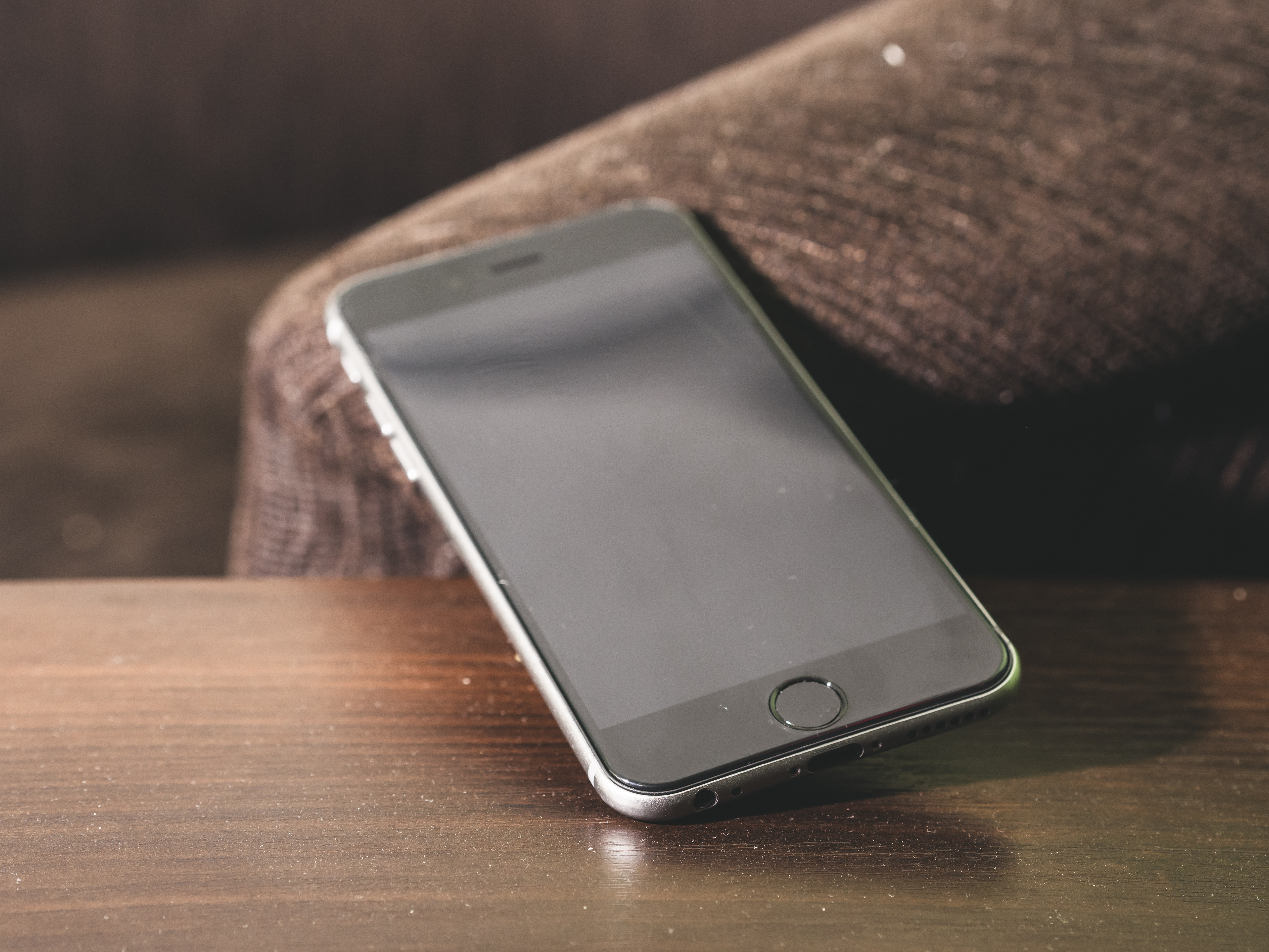 Black Switched Off Iphone On The Wooden Table Free Image