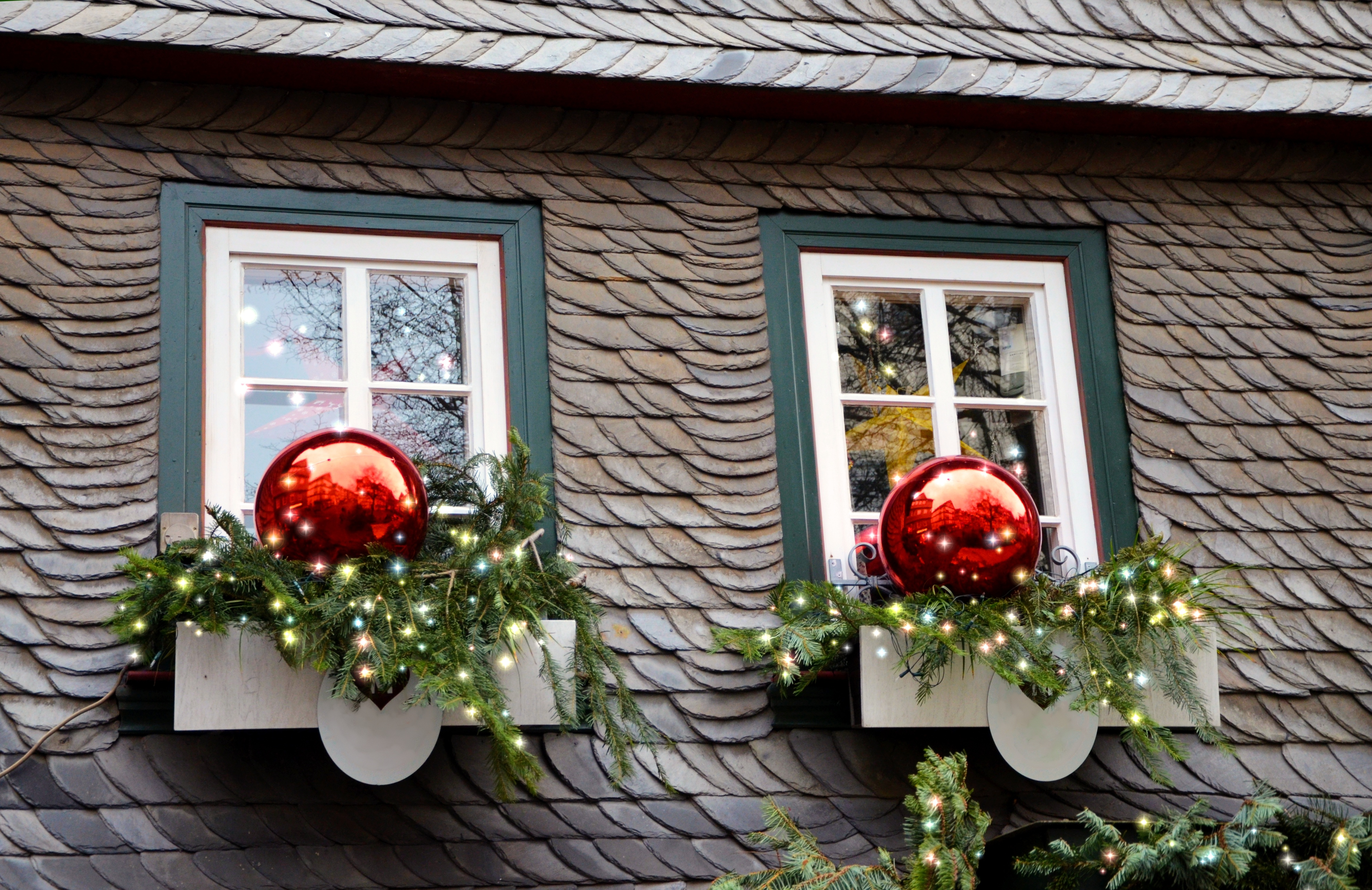 Christmas Decorations On The Windows Of The House Free Image