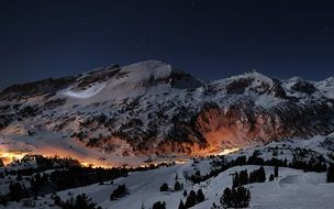 city lights on mountain side at winter night