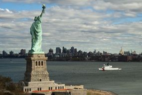 side view statue of liberty at new york city skyline, usa