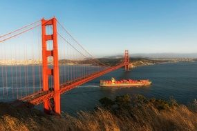 cargo ship under golden gate bridge, usa, california, san francisco