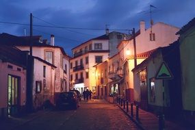 cobblestone street in old town at dusk