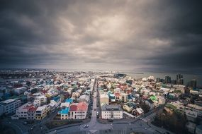 aerial view of city at sea with colorful buildings under cloudy sky, iceland, Reykjavik