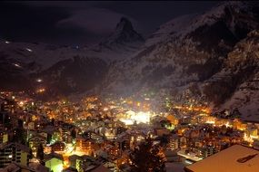 night lights of town at snowy mountain, switzerland