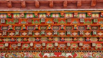 colorful buddhist ornament on temple wall