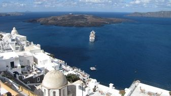 luxury hotels at coast and small islands on sea, greece, santorini