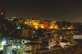 poor run-down apartments at night, brazil, favela