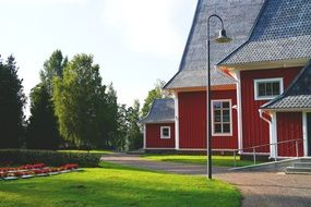 scandinavian style red wooden bar buildings in park