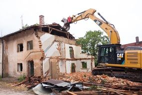 demolition of an emergency building by an excavator