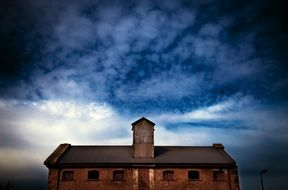 Cloudy sky over old warehouse