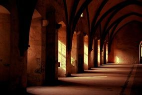 medieval arched hallway in monastery building