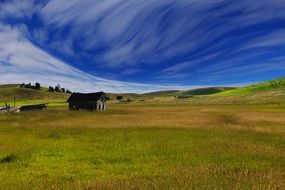 farmland countryside field wooden hut fantastic clouds sky