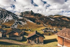 wooden houses in mountain valley at autumn, switzerland