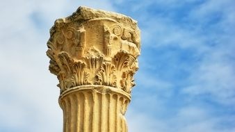 top of damaged ancient corinthian column at sky, turkey, ephesus
