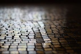 old brown cobblestone pavement close up