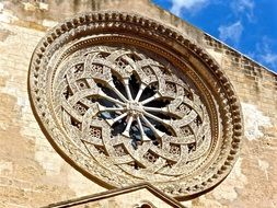 rock ornamental circular window desidn building