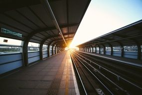 morning sunrays in perspective of subway station