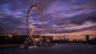 london eye, cityscape with ferris wheel at evening sky, uk, england