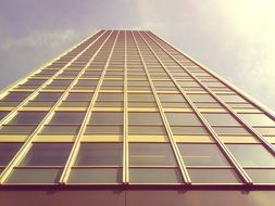 low angle view of tall office building at sky
