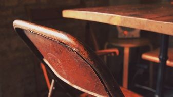 grunge metal chair at table