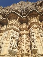 stone carving on facade of Ranakpur Jain temple, india, rajasthan