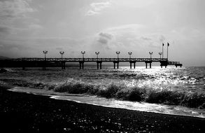 jetty black and white beach spain