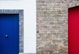architecture brick wall paint red-blue door