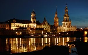 old town mirroring on elbe river at night, germany, dresden