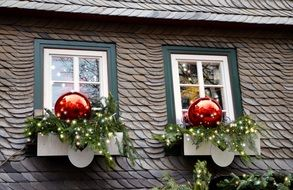 Christmas decorations on the windows of the house