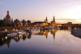 old town and boats on elbe river at evening, germany, dresden