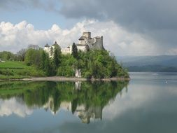 poland castle niedzica water reflection clouds day view