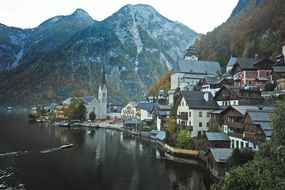 picturesque old village on lake shore at mountains, austria, hallstatt
