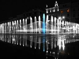 fountain water city night poznan