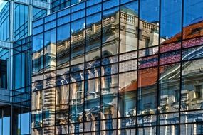 building reflection on glass facade, czech, prague