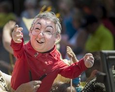 puppet man in person's hands on street at festival