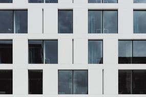 office building facade with narrow and square windows