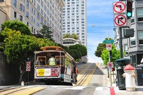 cable car on railroad at cityscape, usa, california, san francisco