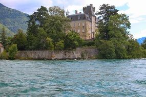 castle on the banks of annecy lake France