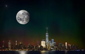 full moon in night sky above new york city skyline, usa, manhattan