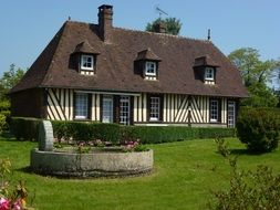 timber framed farmhouse on lawn, france, barville, eure