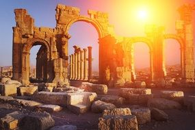 Monumental Arch of Palmyra ruins at sunset, syria