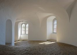 old tower interior with white walls and stone floor, Denmark, copenhagen