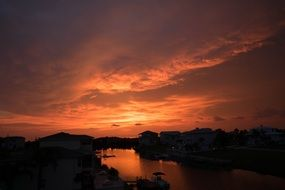 orange sunset sky above calm water at countryside, usa, florida