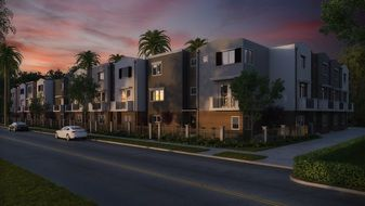new two storey apartments on street at dusk