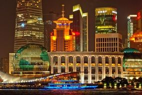 bright colorful night lights in skyline of modern city, china, shanghai