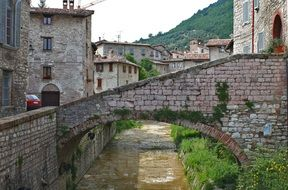 picturesque old stone buildings at mountain, italy, umbria, gubbio