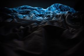 dark blue bed cover surface