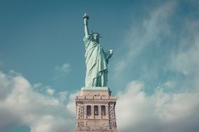 statue ofliberty above clouds, usa, nyc