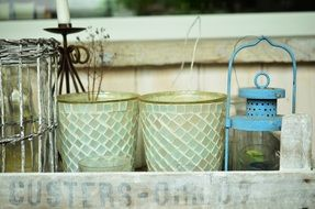 flower pots and lantern in wooden box