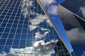 front face buildings clouds reflection glass
